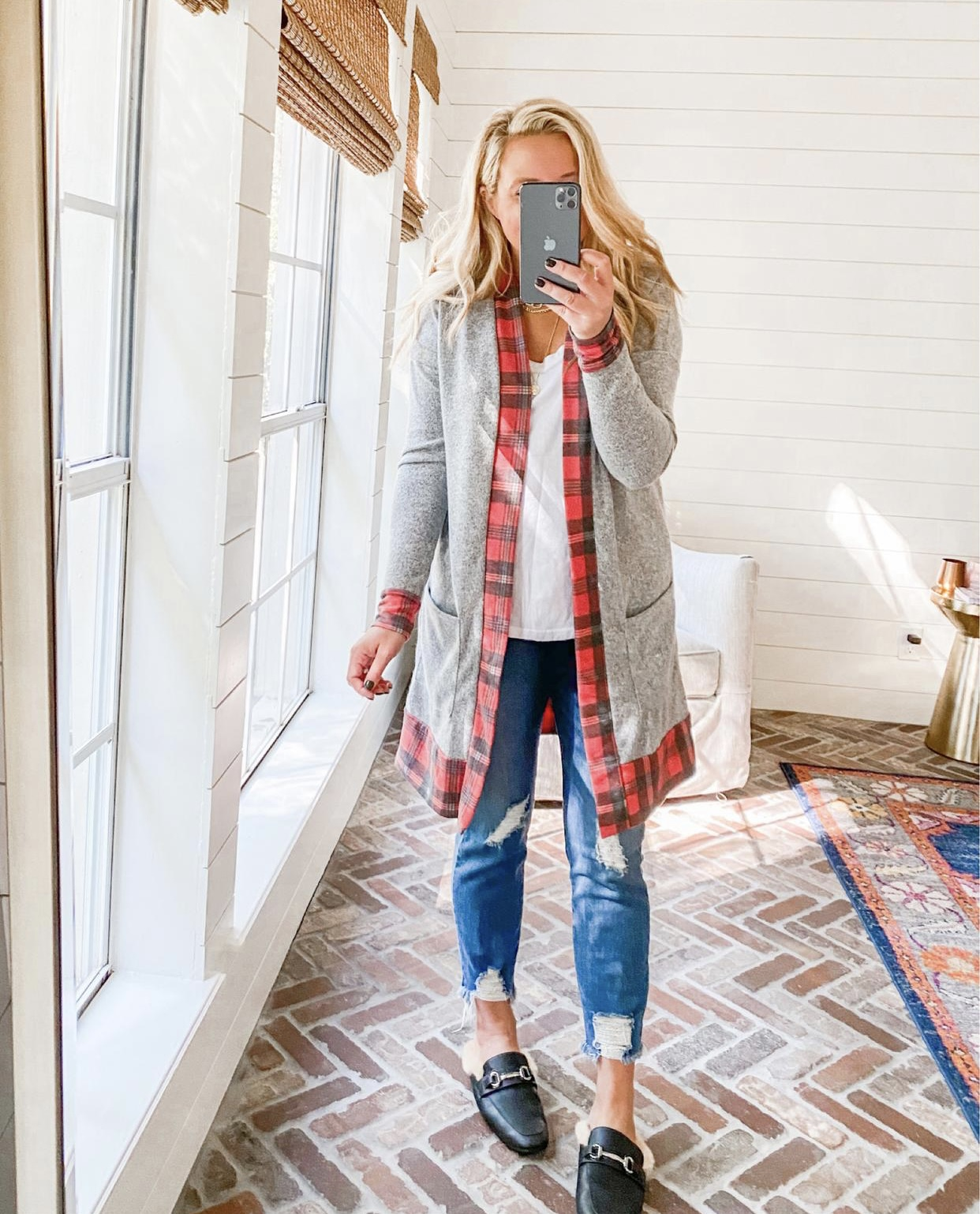 Cute Fall Outfits by popular Houston fashion blog, Fancy Ashley: image of a woman wearing a red plaid and grey cardigan, distressed jeans, and faux fur lined slide mules.