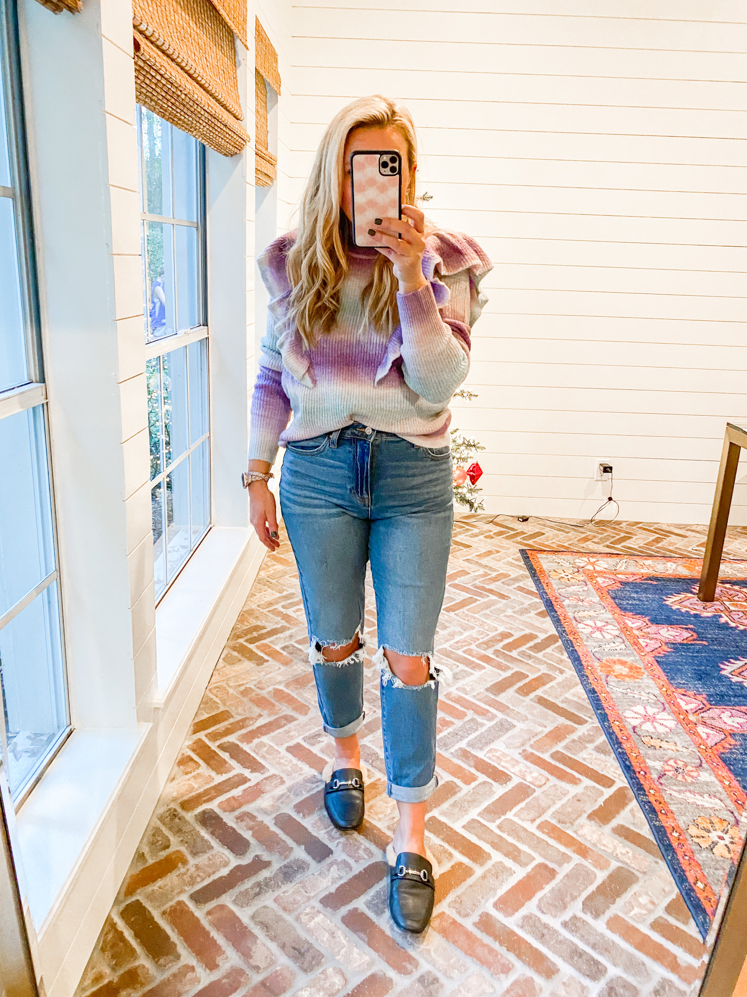 Walmart Womens Clothes by popular Houston fashion blog, Fancy Ashley: image of a woman wearing a Walmart Scoop Women's Space Dye Sweater with Ruffle Trim, faux fur lined black mules, and Walmart No Boundaries Juniors' Mom Jeans.