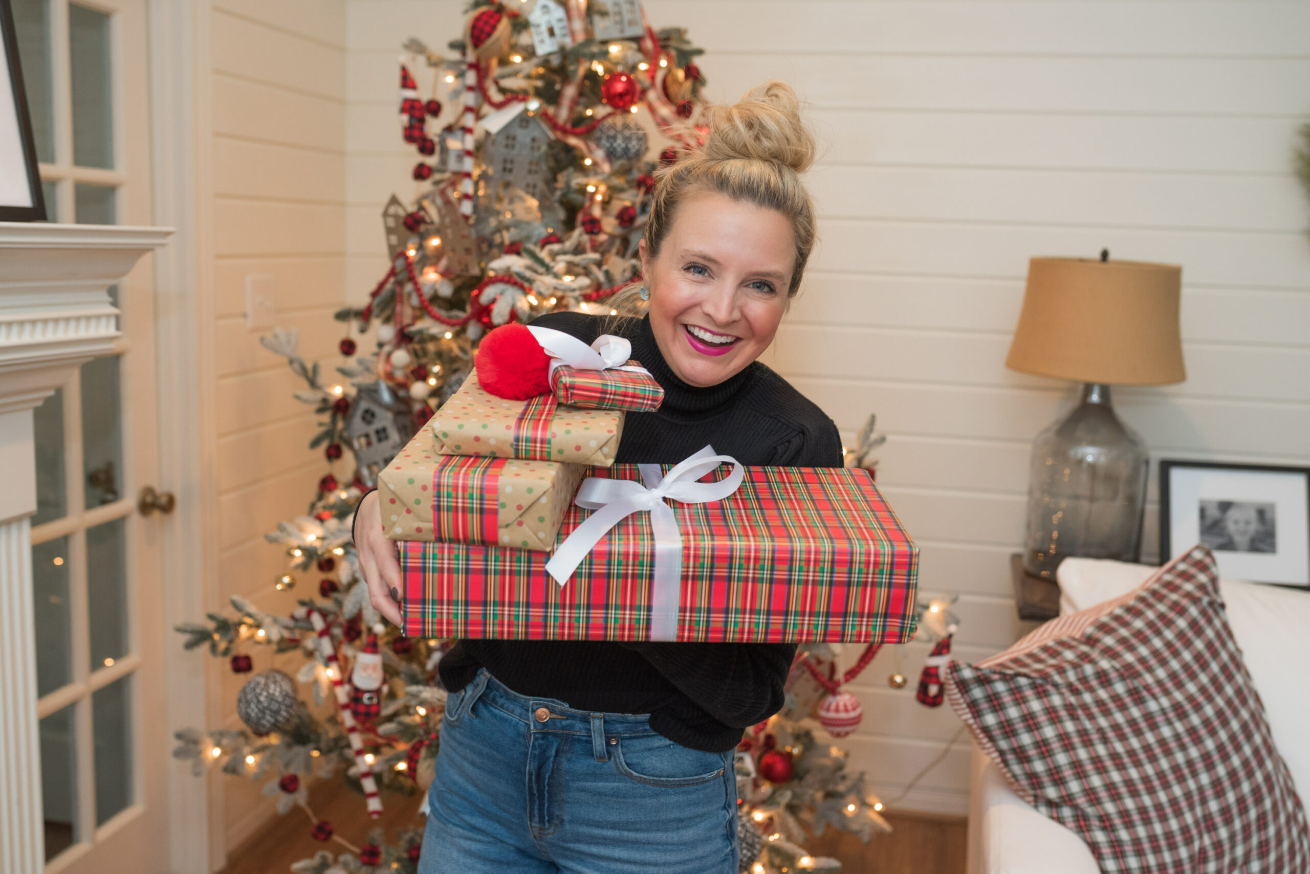 Walmart Gift Ideas by popular Houston life and style blog, Fancy Ashley: image of a woman holding wrapped packages in her arms.