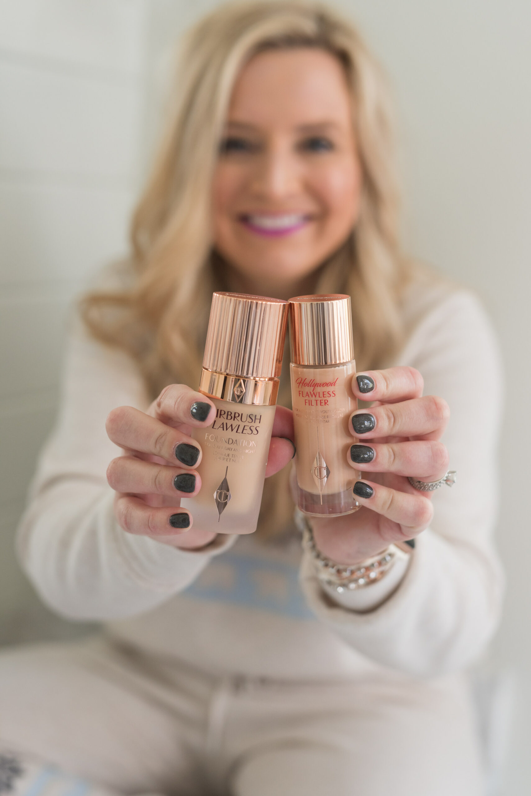 Nordstrom Beauty by popular Houston beauty blog, Fancy Ashley: image of a woman holding Clinique foundation.