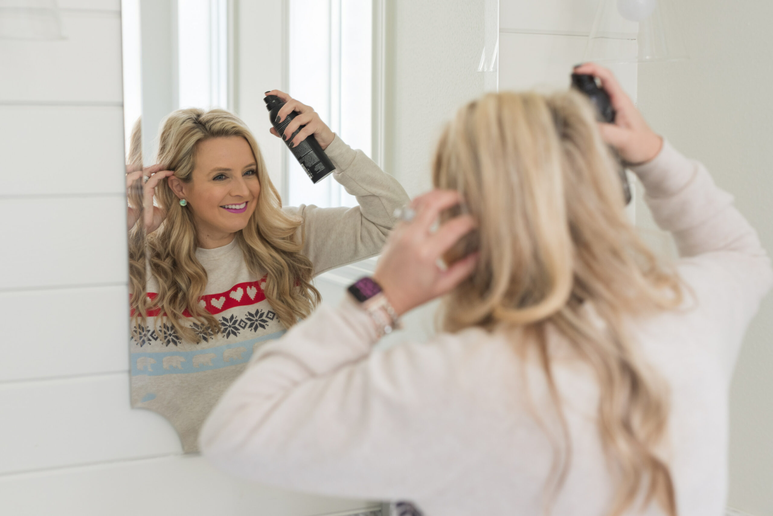 Nordstrom Beauty by popular Houston beauty blog, Fancy Ashley: image of a woman using Living Proof hairspray.
