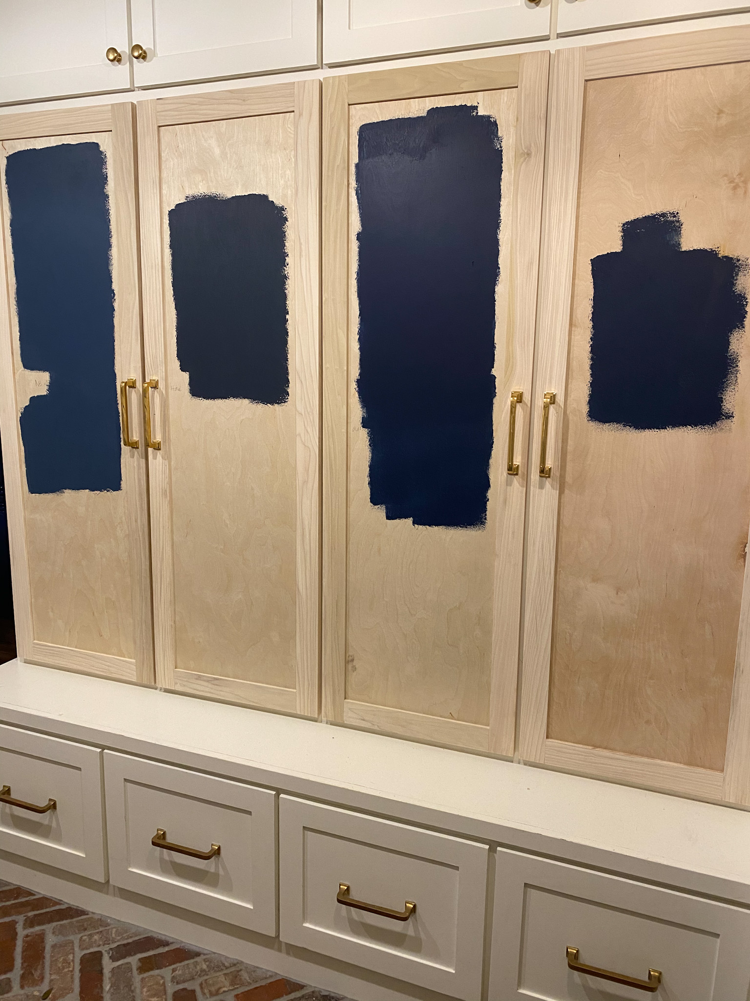 Navy Blue Paint by popular Houston life and style blog, Fancy Ashley: image of cabinets painted in navy blue paint.
