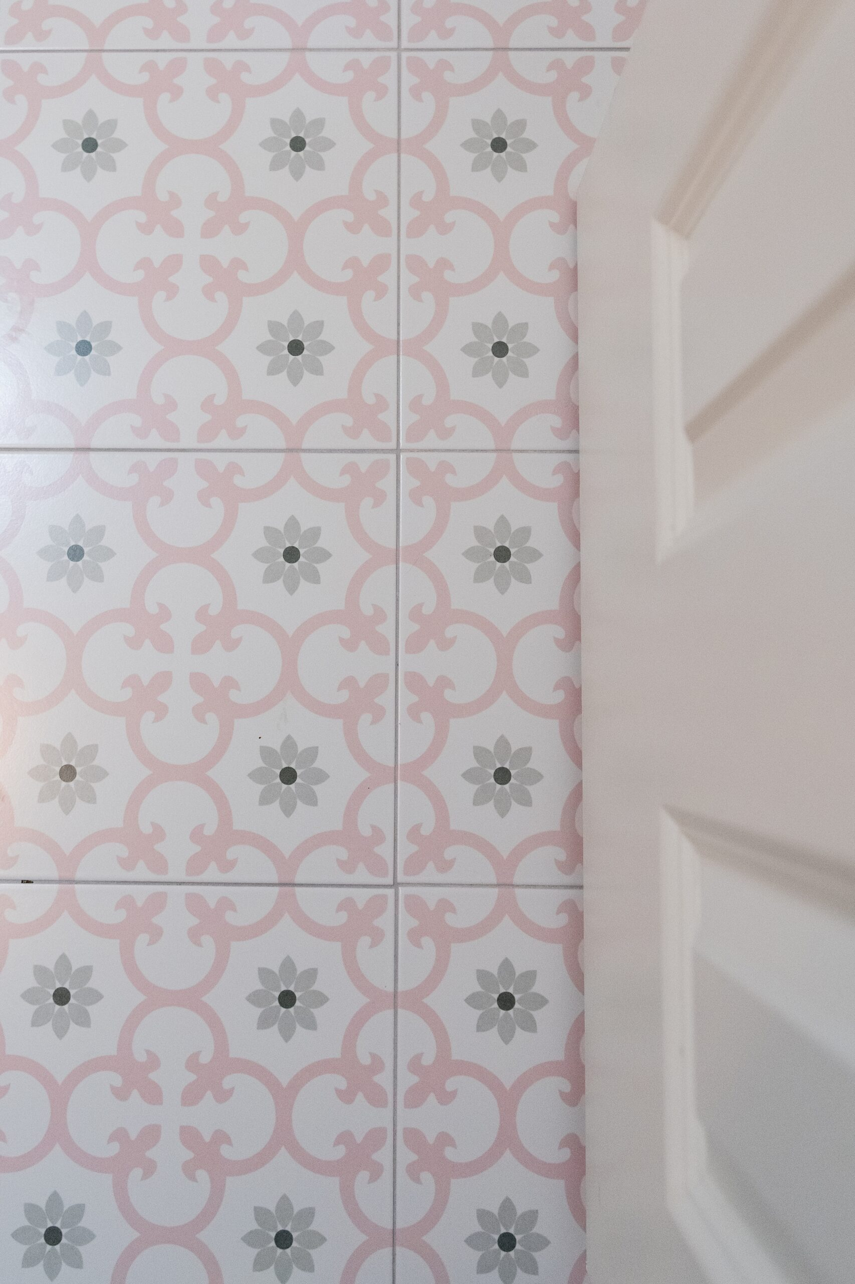Girls Bathroom by popular Houston life and style blog, Fancy Ashley: image of a bathroom pink and grey tile flooring.