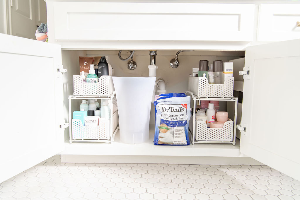 Under Bathroom Sink Organization by popular Houston lifestyle blog, Fancy Ashley: image of a bathroom under sink cabinet organize with a 3 drawer systems and a clear garbage can.
